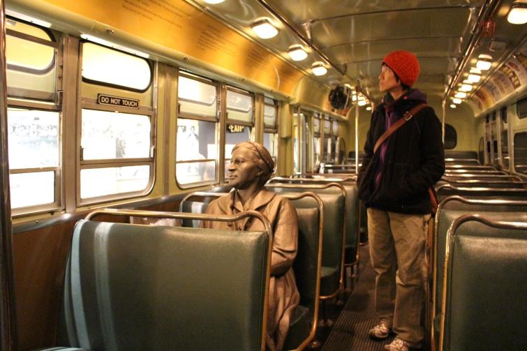 Aya standing beside Rosa Parks