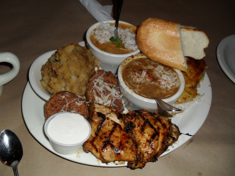 This was our Cajun Share dinner. from left to right: fried green tomatoes, Cajun potatoes, Shrimp and Lobster Etoufee, Gumbo, Chicken, Bread, Catfish.