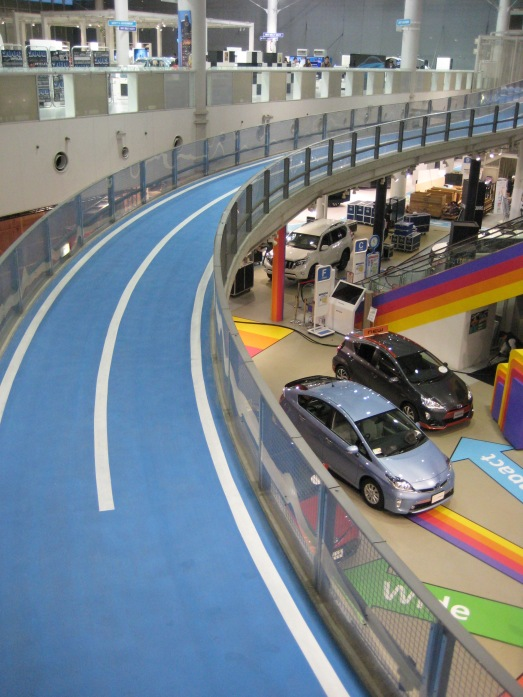 Toyota operates a huge indoor car demonstration area with a full indoor/ outdoor test course.