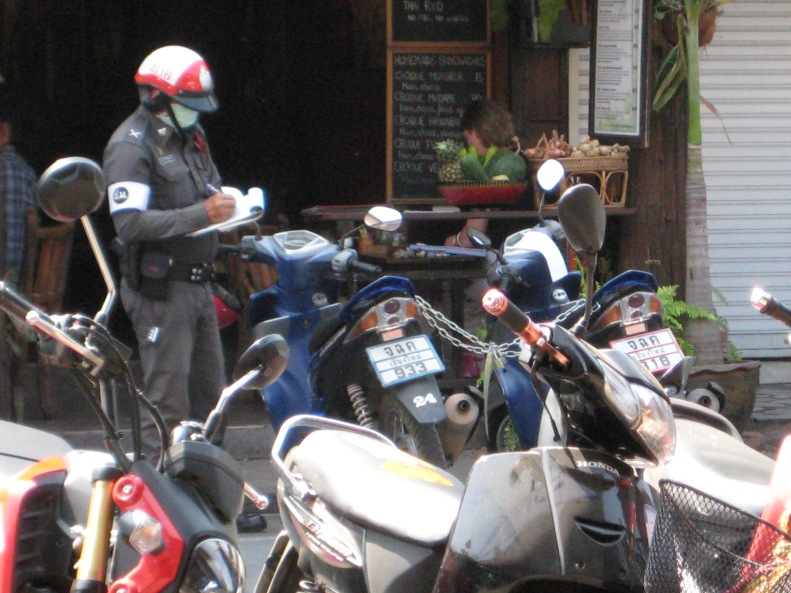 Thai Parking Enforcement Hard at Work (note the scooters chained together)