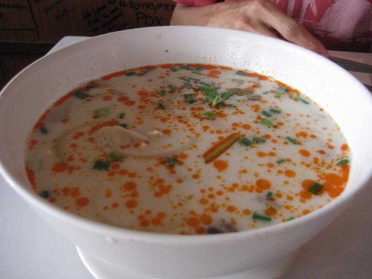 I believe this is Tom Yum Soup, but I might be wrong. I do, however, remember this was out of this world flavor!!!